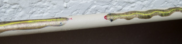 Cute detailed painted along the pipe that runs alongside the house.